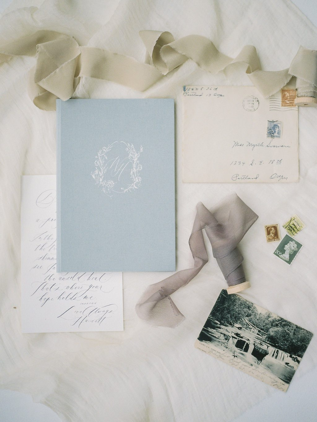 vintage letters vow book hand made wedding story writer vow books heirloom wedding items silk ribbon vintage photos love letters flatlay styling jeremy chou tristan needham design written word calligraphy monogram