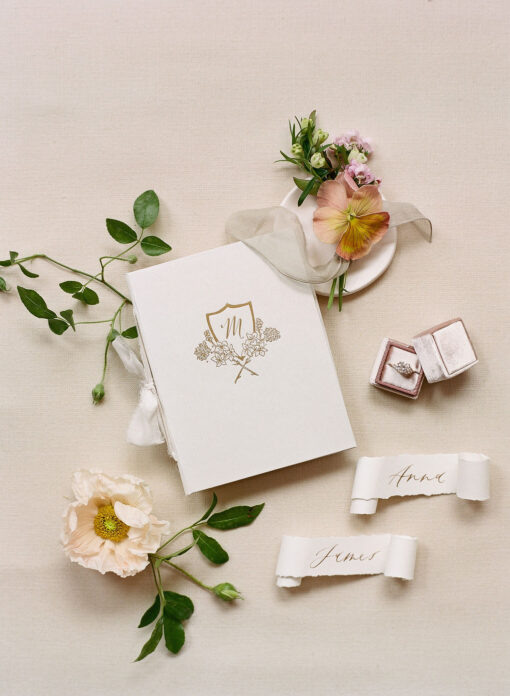 White linen crest fine art vow book Wedding Story Writer
