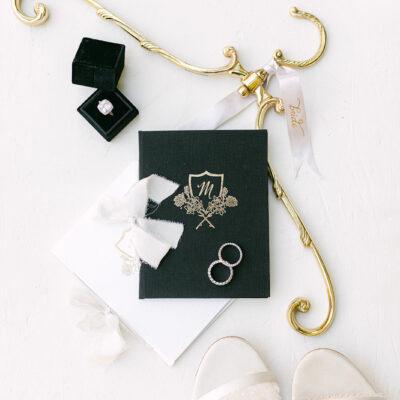 black-m-floral-crest-vow-book
